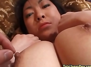 Tittyfucked asian milf sucking cock