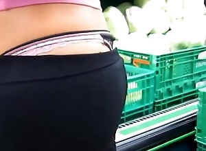 college girl with thong showing in grocery shop close to at collegethongs.com